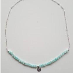 Colgante de plata y ágatas facetadas azules con medalla de angelito de la colección Primera Comunión de la joyería online PlataS